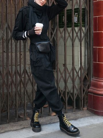 Women's outfit idea for 2021 with black jumper, black casual trousers, black ankle boots. Suitable for spring and autumn.