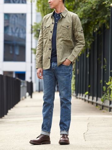 Men's outfit idea for 2021 with overshirt, long-sleeved henley top, mid blue jeans, lace-up leather boots. Suitable for spring and summer.