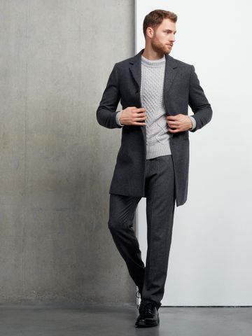Men's outfit idea for 2021 with grey single-breasted overcoat, grey cable-knit jumper, grey plain formal trousers, oxford / derby shoes. Suitable for autumn and winter.