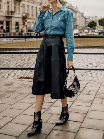 Women's outfit idea for 2021 with blue blouse, black skirt, black ankle boots. Suitable for autumn.