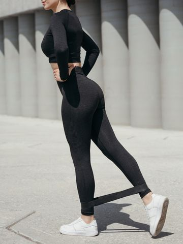 Women's outfit idea for 2021 with black sports top, black sports leggings, black sports accessory, white trainers. Suitable for spring, summer, fall and winter.